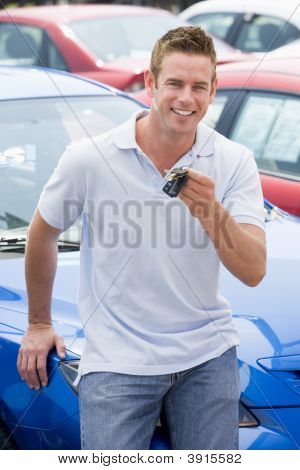 Man Sat On Car With Keys