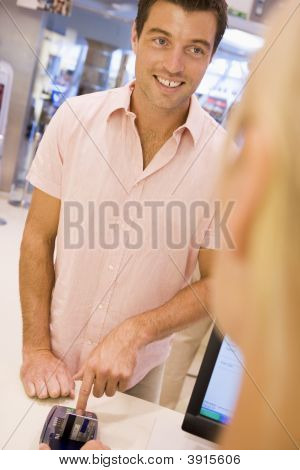 Man Paying With Card In Shop