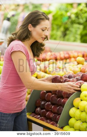 Woman Choosing Fruit In Shop