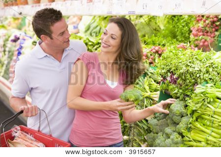 Couple Choosing Vegetables From Shop