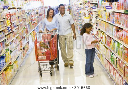 Man And Child Choosing Vegetables In Shop