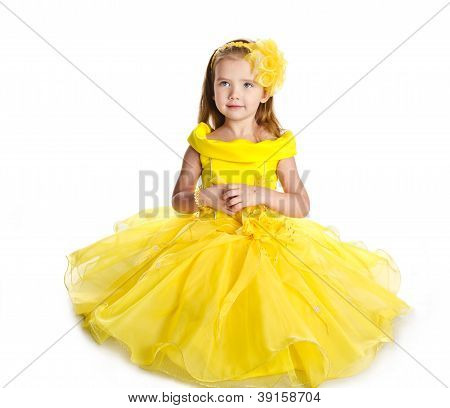 Cute Sitting Little Girl In  Princess Dress Isolated