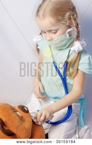 Little Caucasian Blond Girl Making Toy Treatment
