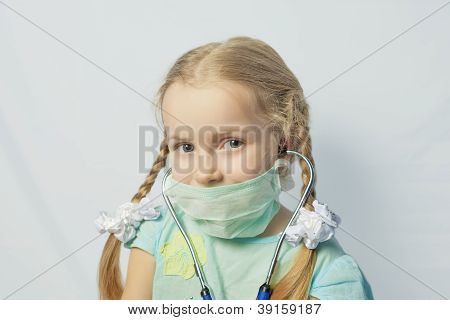 Little Caucasian Blond Girl Wearing Medical Mask