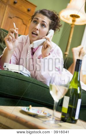 Woman Sat On Phone Smoking
