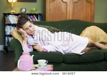 Woman Looking Sad On Sofa