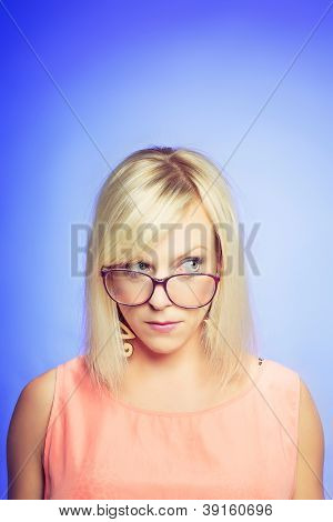 Skeptical Young Woman With Large Glasses