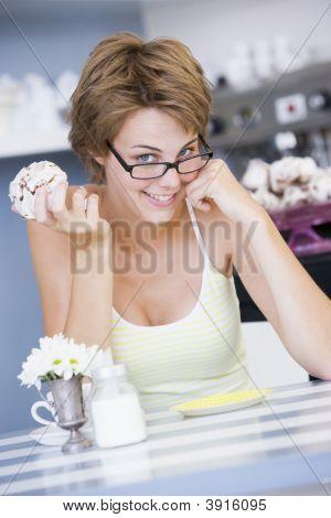 Woman On Table Drinking Tea