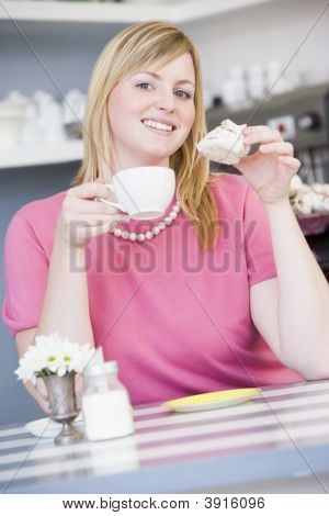Woman With Cream Cake And Tea In Hand