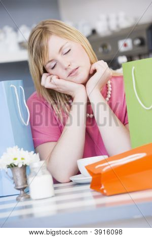 Woman Tired After Day Of Shopping