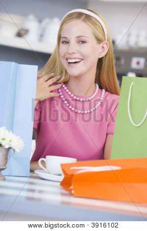 Woman With Shopping Bags On Table