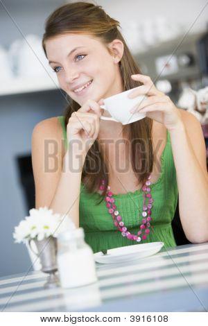 Woman Drinking Tea In Tea Room