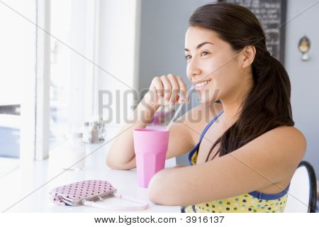 Woman Sat Drinking In CafŽ