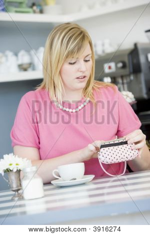 Woman Frustrated At Money In Purse