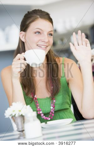 Woman Waving In Tea Room