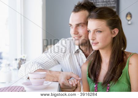 Couple Sat In CafŽ Drinking
