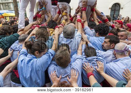 Castellers, braços de apoio da Torre