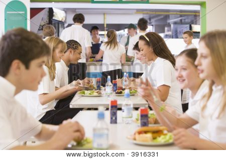 Teen Pupils In School Canteen On Lunch Break