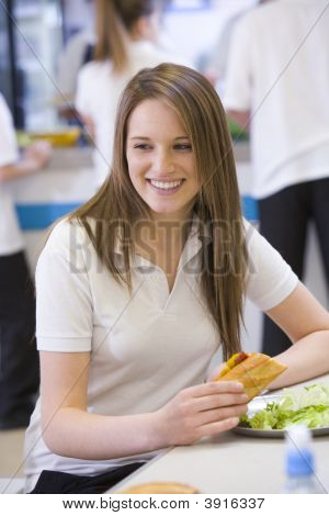 Portrait Of Teen Pupil In School Canteen On Lunch Break