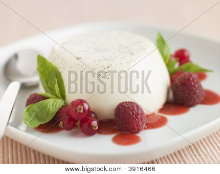 Vanilla Panna Cotta With Raspberries Redcurrants And Coulis