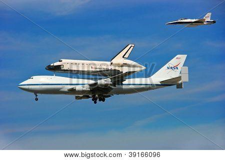LOS ANGELES, CALIFORNIA, USA - SEPTEMBER 21: Space Shuttle Endeavour makes dramatic final flight around Los Angeles Downtown on September 21, 2012 in Los Angeles, California