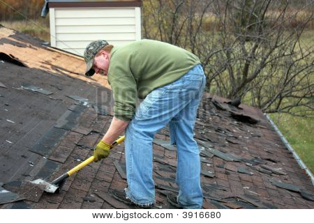 Roofer Removing Shingles