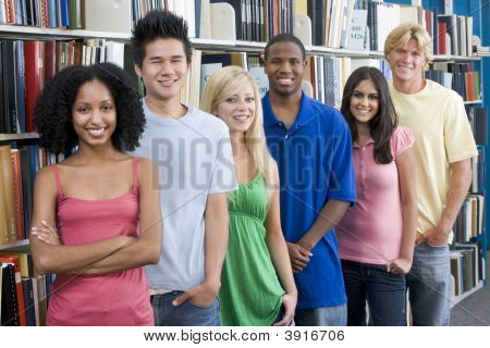 Six People In Library Standing By Bookshelves