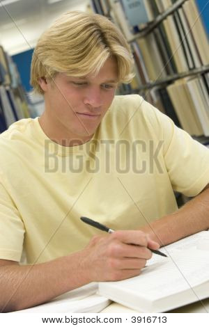 Man Sitting In Library Studying