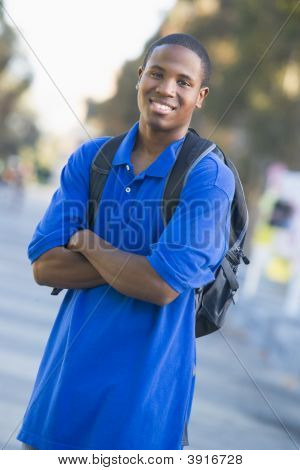 Man Standing Outdoors Smiling (Selective Focus)