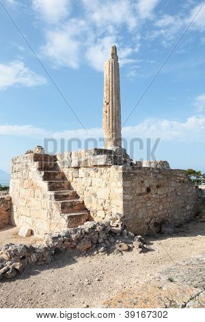 The one ancient column still standing at the 6th Century BC temple to the sun god Apollo on the island of Aegina south of Athens, Greece.