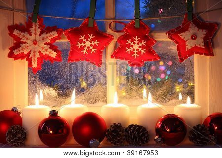 Frosted window with Christmas decoration