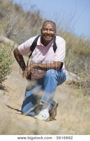 Senior Man On A Walking Trail