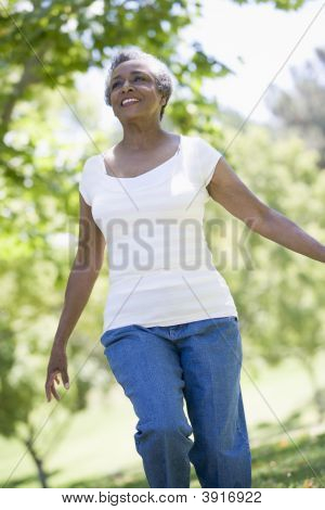 Senior Woman walking im park