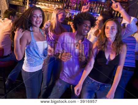 Young People Dancing In A Bar