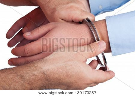 Men with a gun and handcuffs