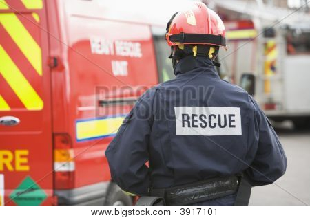 Rescue Worker Walking Back To Rescue Vehicle