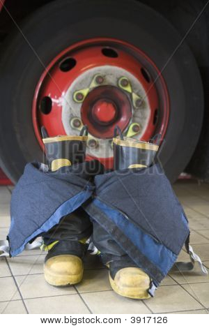 Firefighting Uniform On Floor By Fire Engine