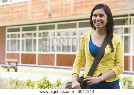 Student Standing Outdoors Smiling