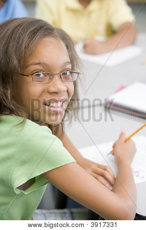 Student In Class Writing (Selective Focus)