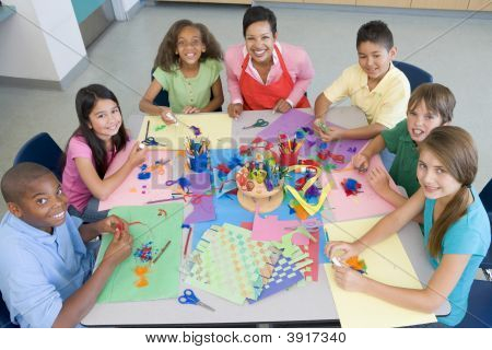 Teacher And Students In Art Class