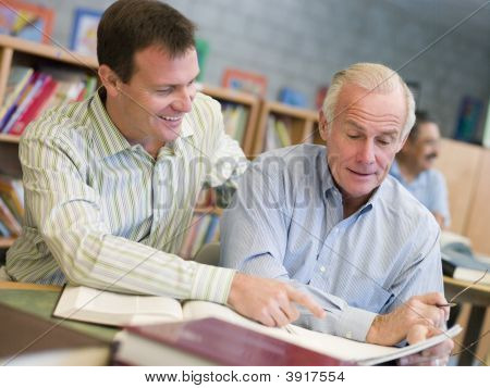 Two Men In Library Talking (Selective Focus)