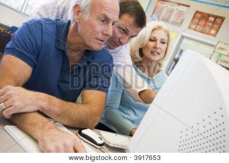 Three People At Computer Terminal