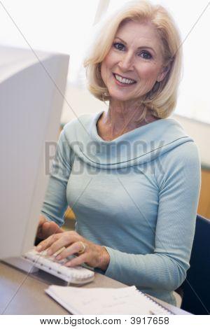 Woman Sitting At Computer Typing (High Key)