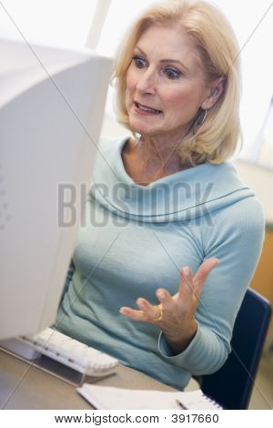 Woman Sitting At Computer Frustrated (High Key)