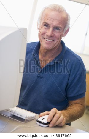 Man At Computer Smiling (High Key)