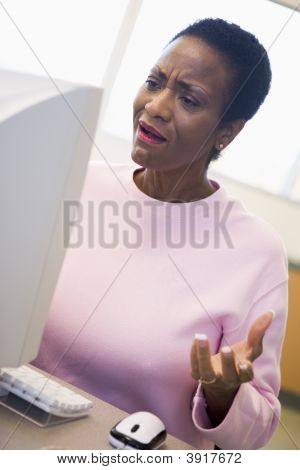 Woman At Computer Looking At Monitor Frustrated (High Key)