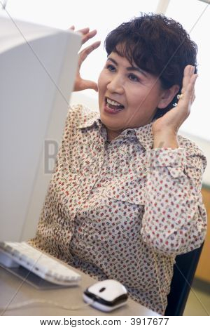 Woman At Computer Looking At Monitor Surprised (High Key)