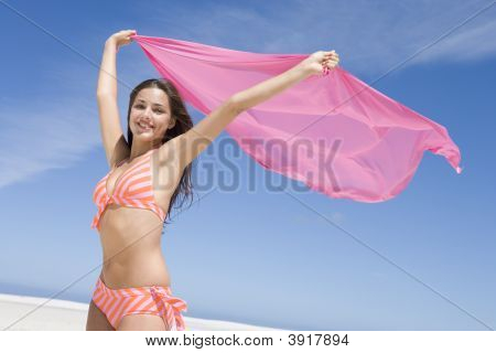 Young Woman Posing With A Scarf On A Beach