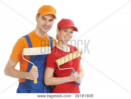 Portrait of two male and female house painter worker with painting roller isolated