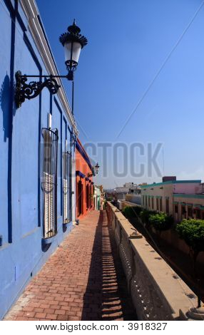 Brightly Painted Houses On Old Pathway